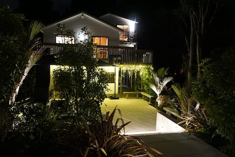 Our property at night - guest ensuite located in lower level & accessed via outdoor living area