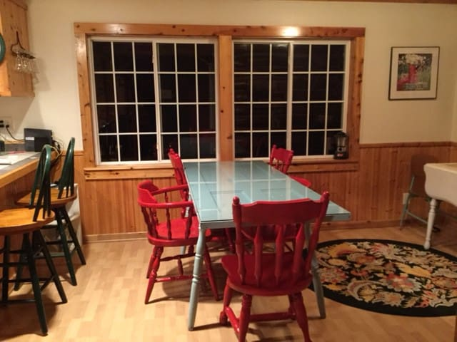 Dining room with breakfast bar and extra drop leaf table can seat 12