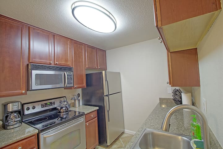 Don't want takeouts during your trip? Let this kitchen help you prepare a homemade meal! Stainless steel appliances, granite counter top, cherry cabinets along with space to accommodate any cooking taste small or large.