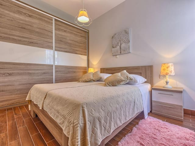 Bedroom with queen size bed and big wardrobe