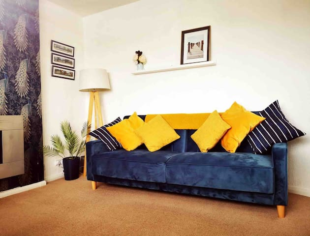 The Lounge featuring:  TV - Netflix - Amazon Prime - Hulu - Starzplay - Shudder  A cosy electric fire  Views over the sand dunes  A drop leaf extendable table  Two click clack small double sofa beds.