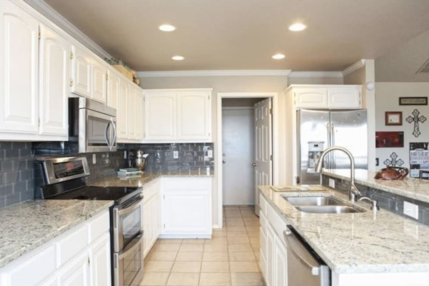 Updated granite kitchen and stainless steel appliances. Hope you enjoy as much as we do! Large fridge to hold items from eating out for your convenience. Large pantry through door to keep any non-perishables as well.