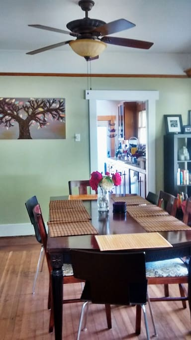 Bright dining room with large kitchen table.