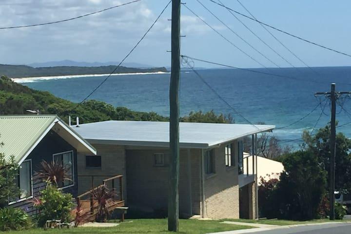 Beach house - stroll down the hill to the beach