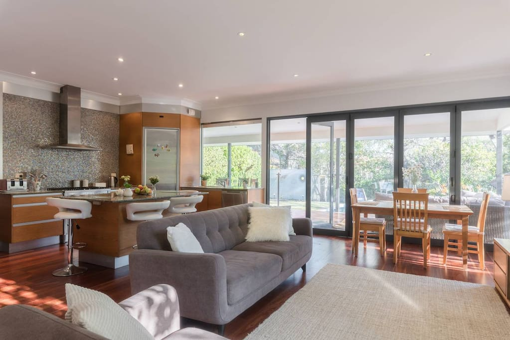 Sun-filled lounge with an open-plan kitchen