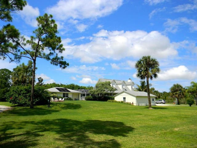 2.5 Acre Jupiter Oasis with Solar Heated Pool!