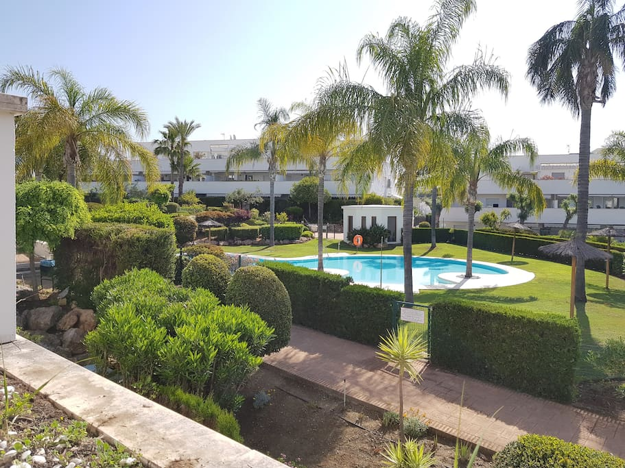 From the terrace, you can enjoy the tropical garden & pool view...and watch the kids swimming!
