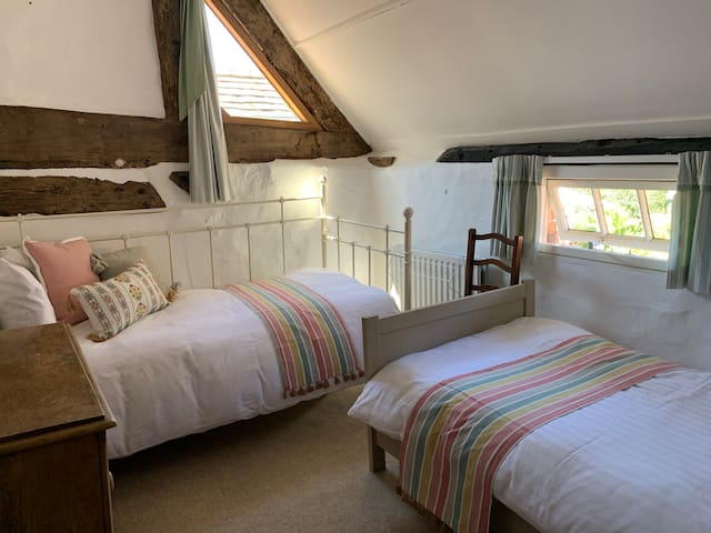 Twin room in a private wing of a farmhouse.