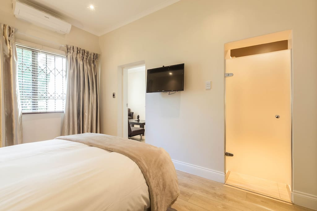 En-suite bedroom with LCD television