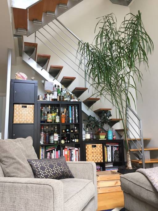 Double-height loft ceilings. Stairwell to mezzanine level and upwards to private roof.