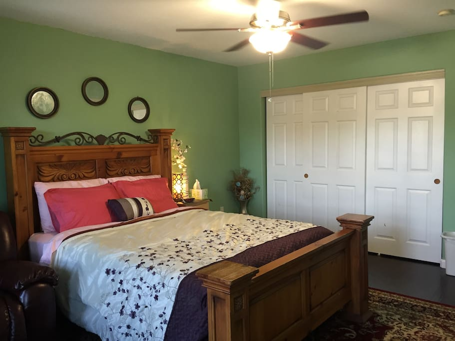 New designer comforter (extra comforters and pillows in the closet)
