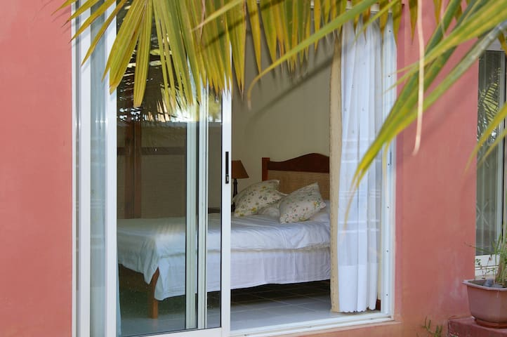 Main bedroom with comfortable double bed and sea view