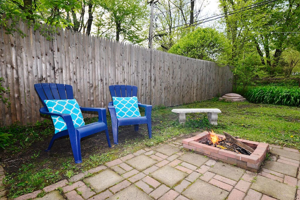 Backyard with firepit and sandbox