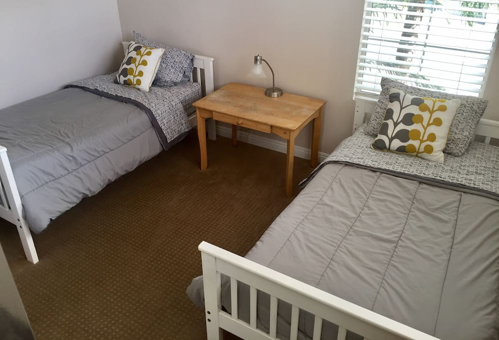 Two twin beds in bright 2nd bedroom