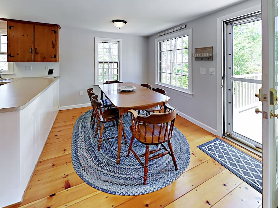 Large windows flood the dining area with natural light.