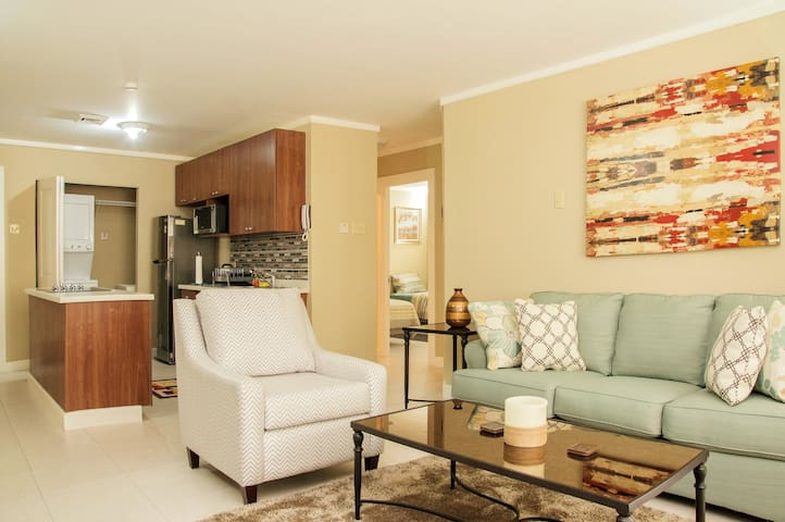 Clean spacious and simple design with modern styling living room and kitchen. Our home welcomes you.