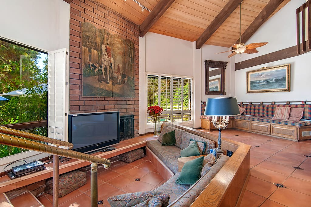 Come together in front of the TV or fireplace on the second living area's sunken couch, or grab a seat on the bench in the corner for conversation.