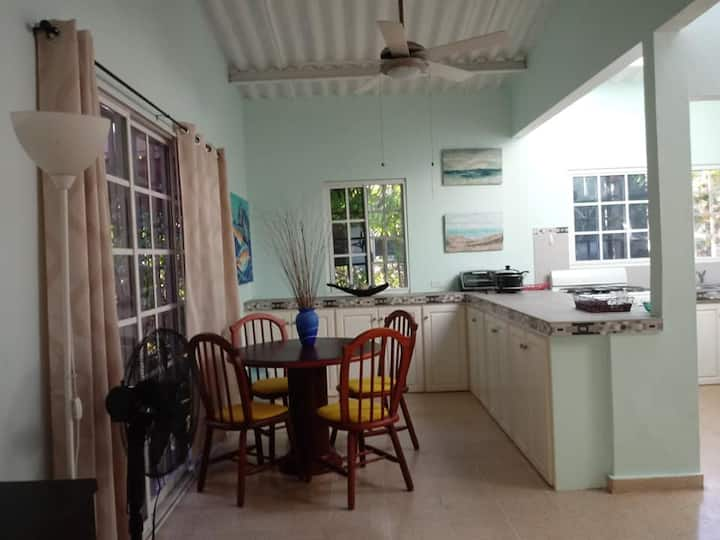 Tropical garden cottage close to the beach
