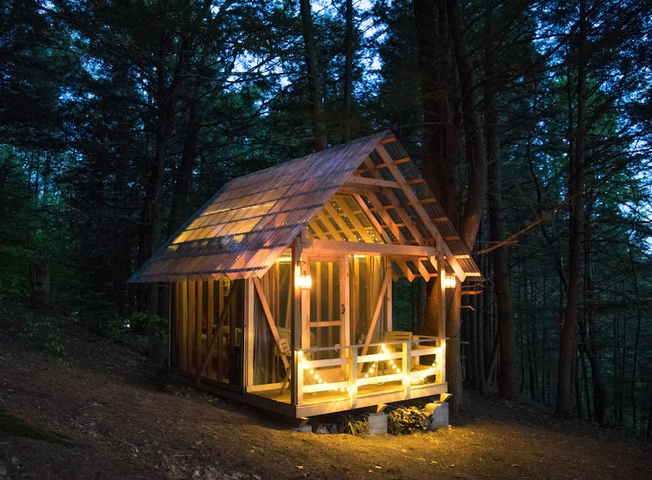 The cabin glows at night