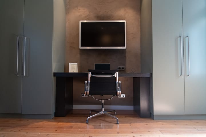 Working desk in the bed room with Internet connected TV