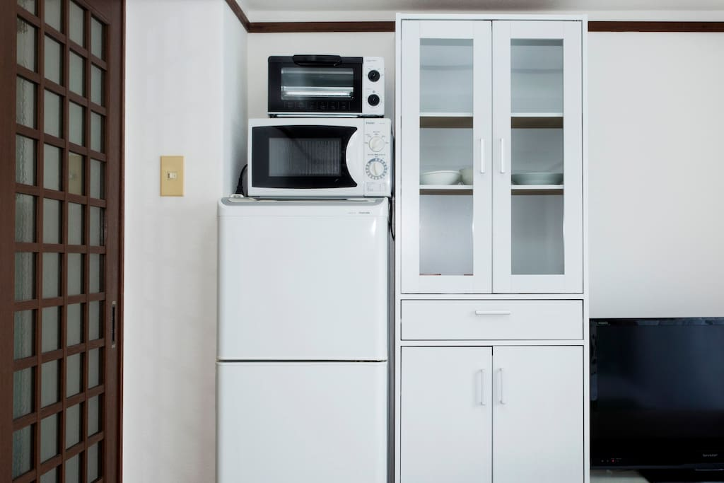 Toaster and a microwave and water heater and refrigerator