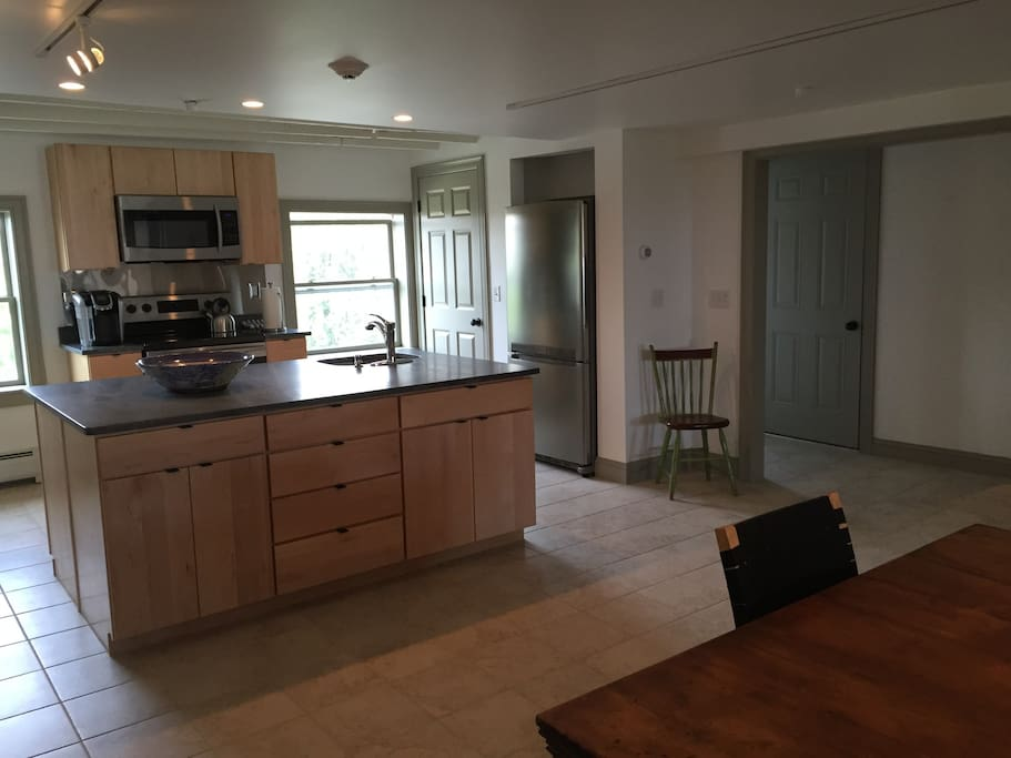 Upper apartment: Brand new kitchen with elegant maple cabinets, large island, and silky soapstone countertops. Completely equipped with cookware and tableware.