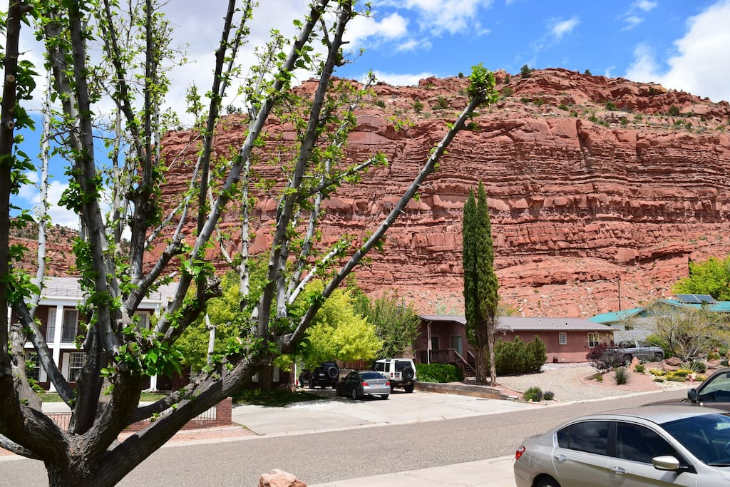 View of red rock cliff from front of house