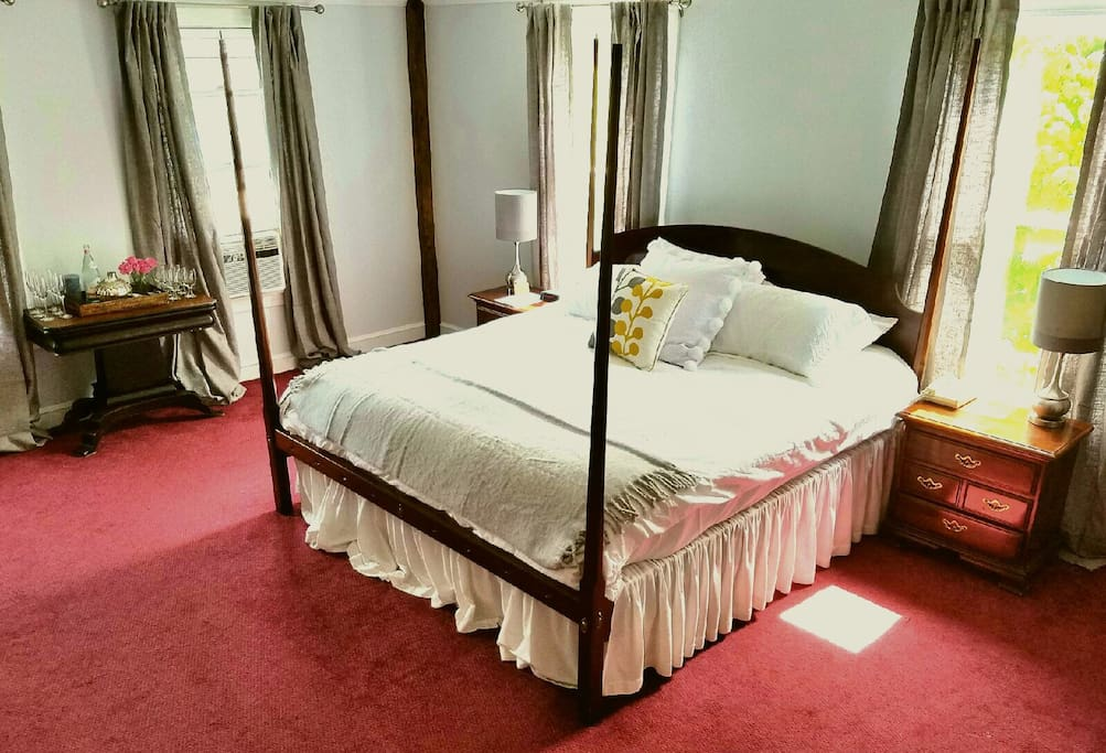 King size bed in spacious room with private bath.
