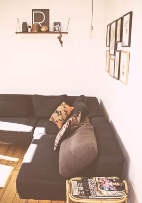 Living includes one big corner sofa with TV