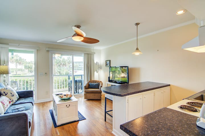 Oceanview condo featuring community pool, basketball court, & fishing pier