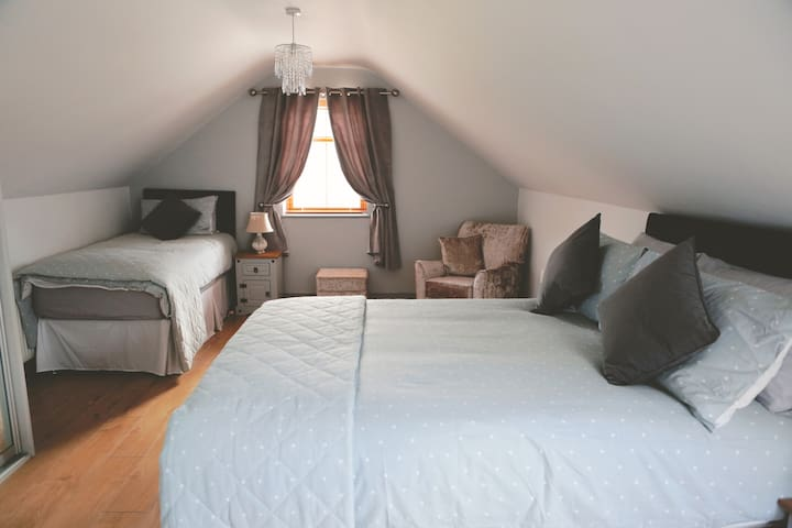 Spacious bedroom on 1st floor with double and single bed.