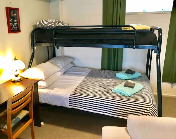 Double/Single bunk bed at the rear of the lounge.