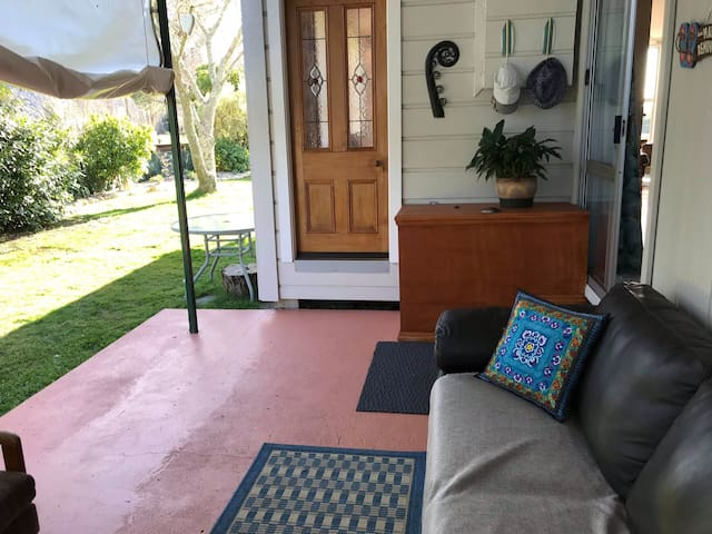 This is your outside enclosed porch and private entrance.