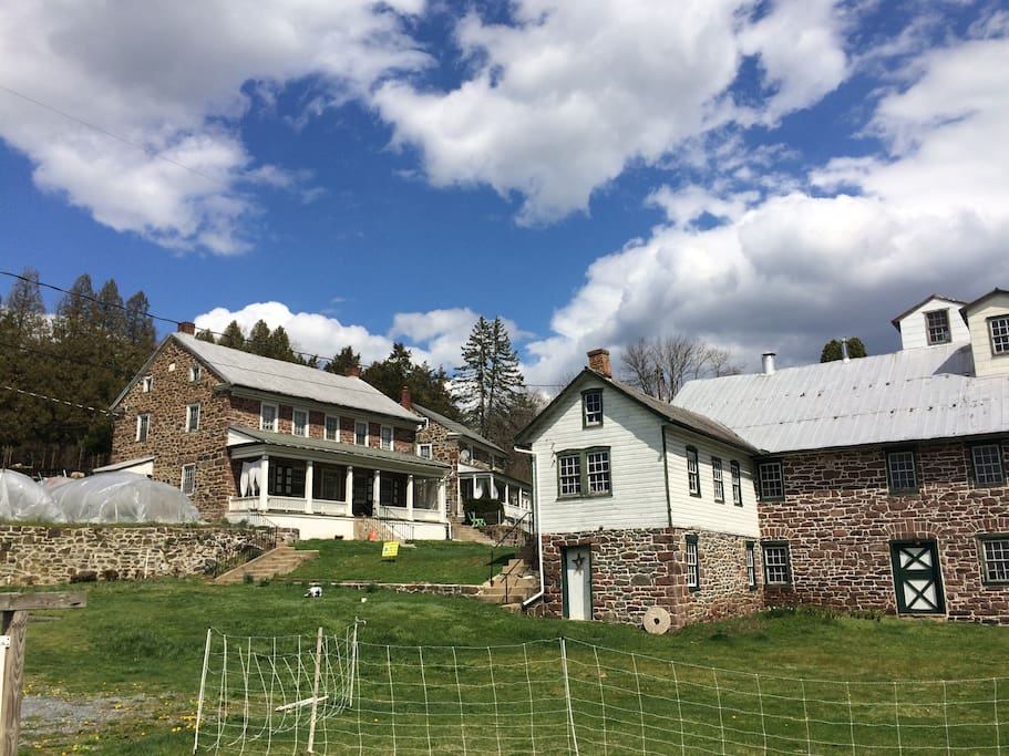 The homestead- we live in the first house. The Miller's Cottage is in the background.  The historic mill is the building on the right.
