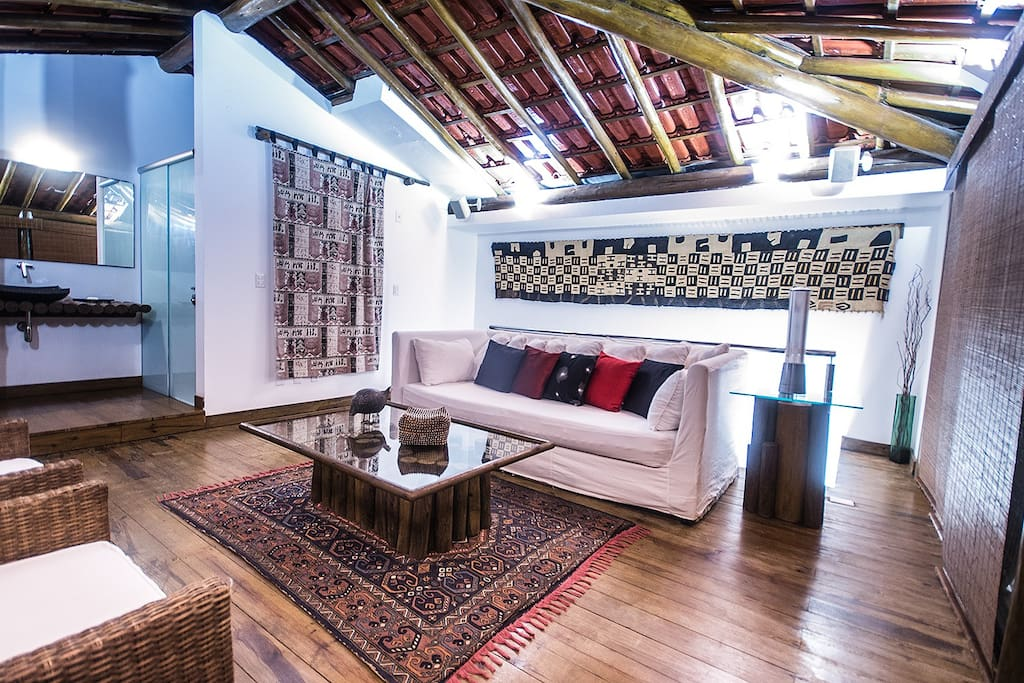 Telhado: living room on 12th floor with exposed beams and red tile roof, African textiles: my favorite room to relax