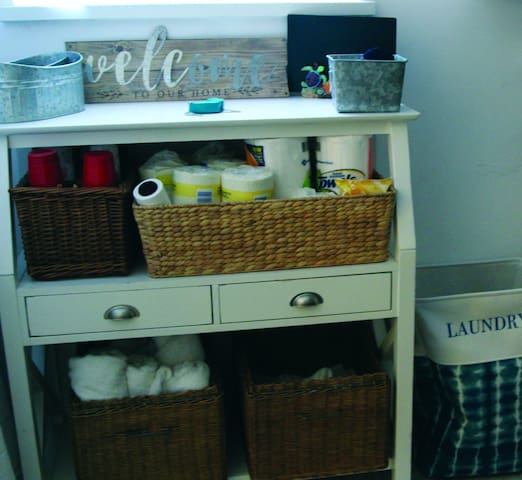 As you enter through your own entrance and come up the first flight of stairs you will come through the laundry room.  This area is stocked with all the supplies for the suite.  If you need anything during your stay,  please help yourself.
