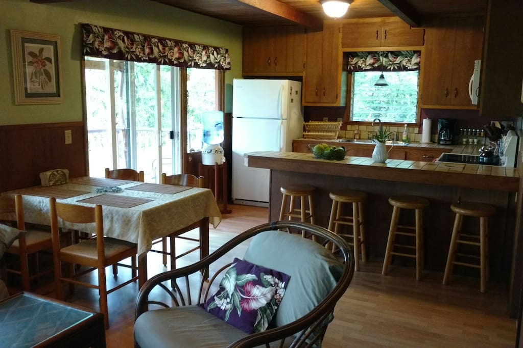 Cottage Dining Areas looking into the Kitchen, and Sliding Glass Door to the Lanai.