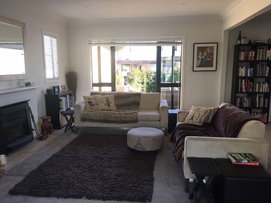 Comfortable, spacious main living room with outdoor flow to north and south facing decks and gardens.