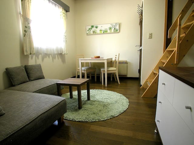 Living space w/sofa and dining table