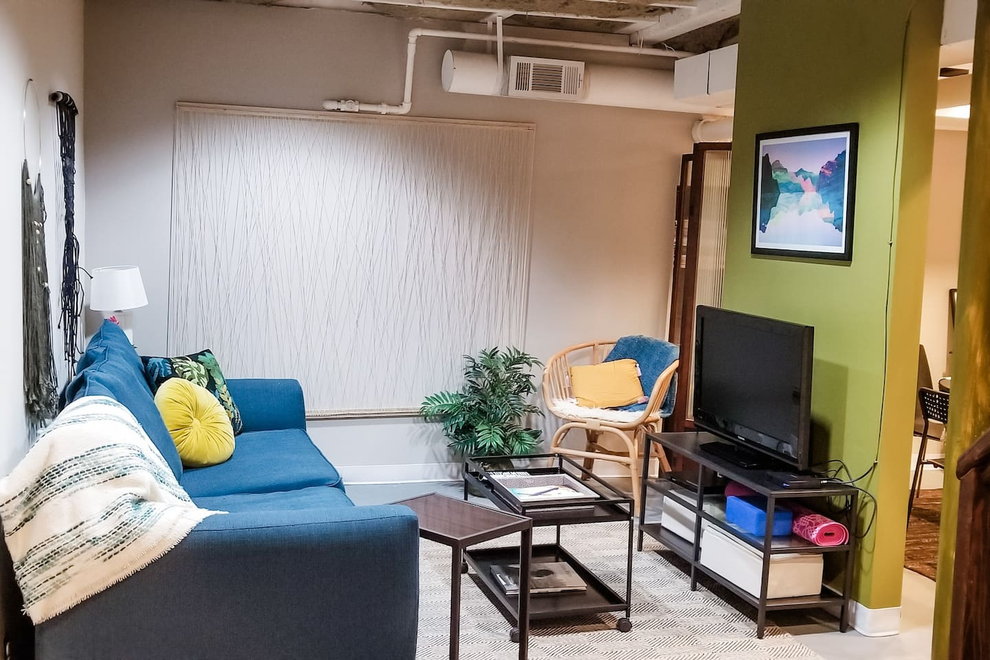 Cozy living room. Features pull-out queen sleeper, seating for 4 easily, Google fiber TV, dvd player, dvds, yoga mat and block