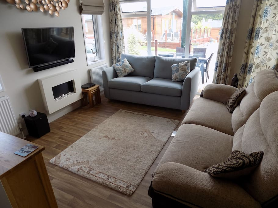 lounge area with a very comfortable reclining sofa opposite the TV and fire