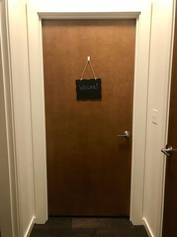 You room is through this door. Welcome!