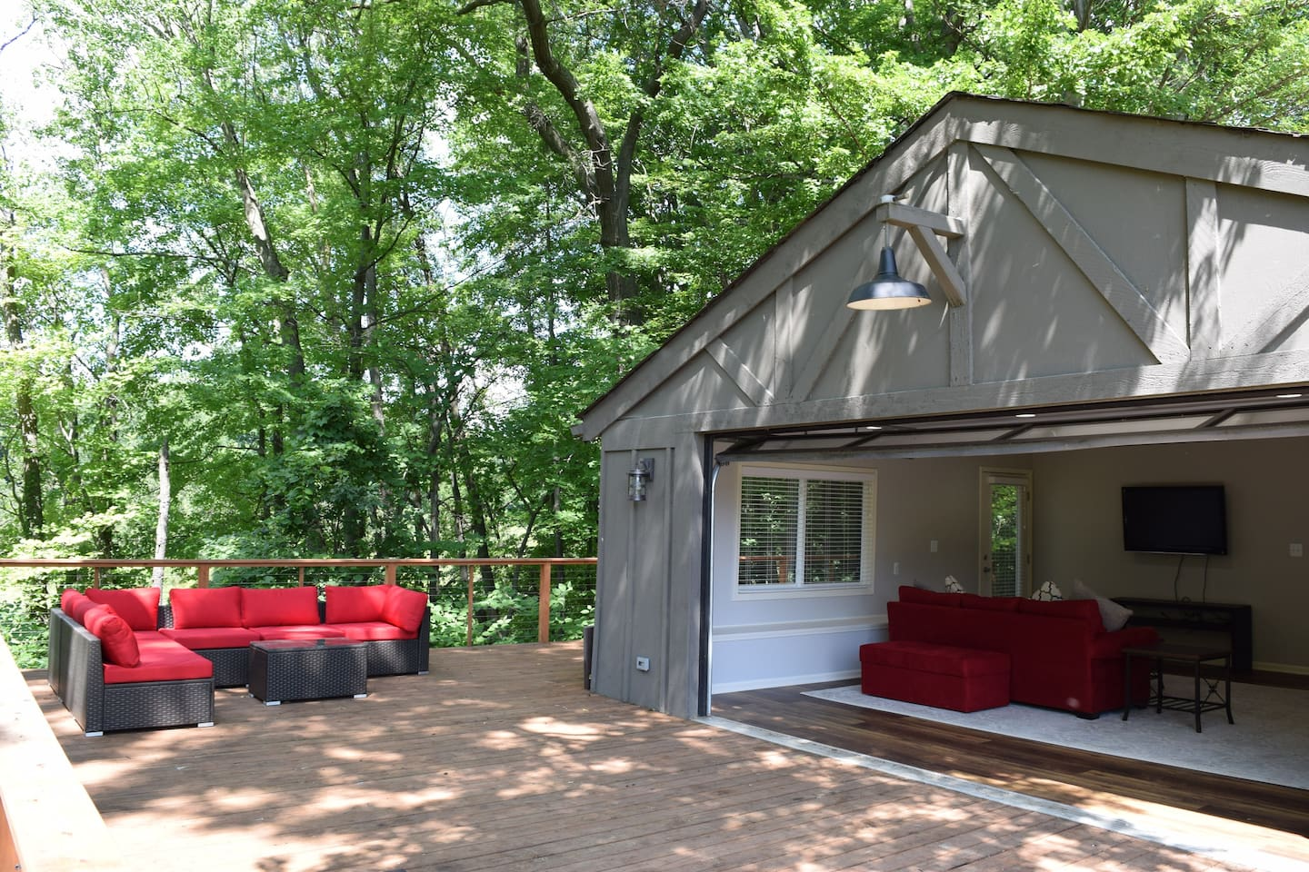 The deck leads seamlessly into one of two spacious living rooms.