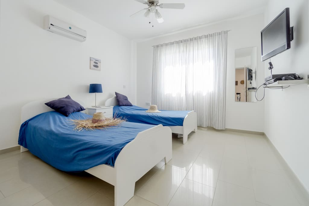 Sunny twin bedroom.