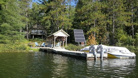 Off grid solar cottage on quiet lake.