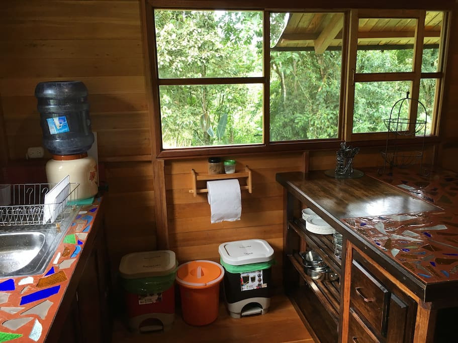 The kitchen is equipped with all essential dishware, drinking water, plus garbage, recycling & a compost bin!