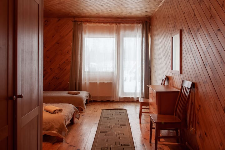 Two single beds/private bathroom near lake Rāzna