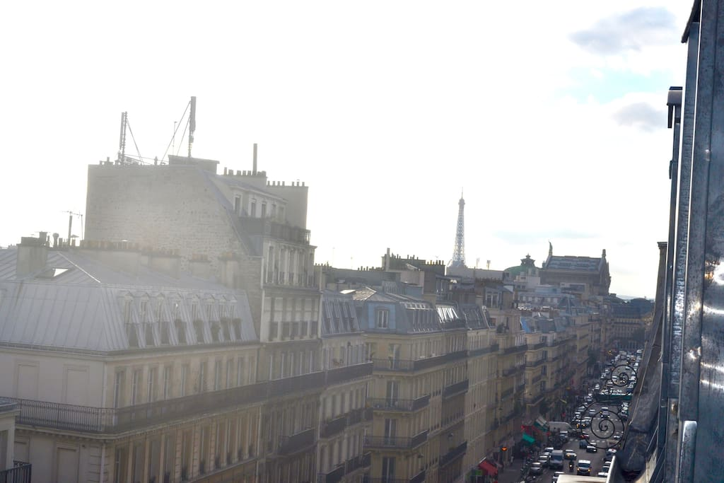 View over the Parisian rooftops, Opera district and the Eiffel Tower.