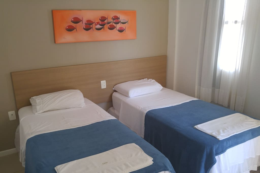 Room with 2 single bed with ar condition + small balcony with ocean view