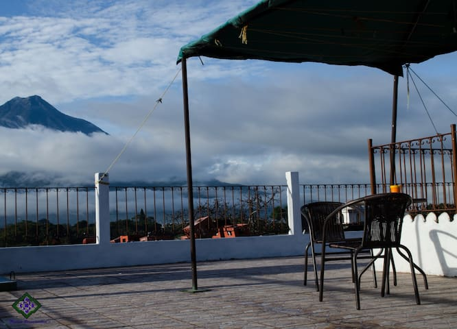 You can share on the Roof-terrace with the beautiful view of the water volcano